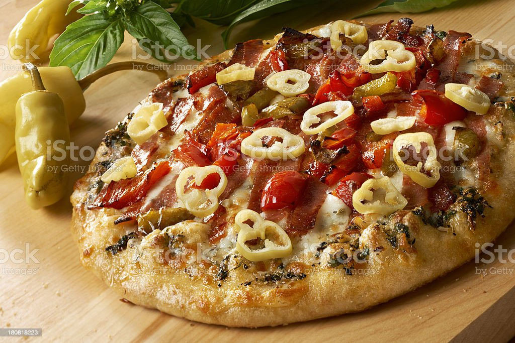 Pizza with Prosciutto and peppers stock photo