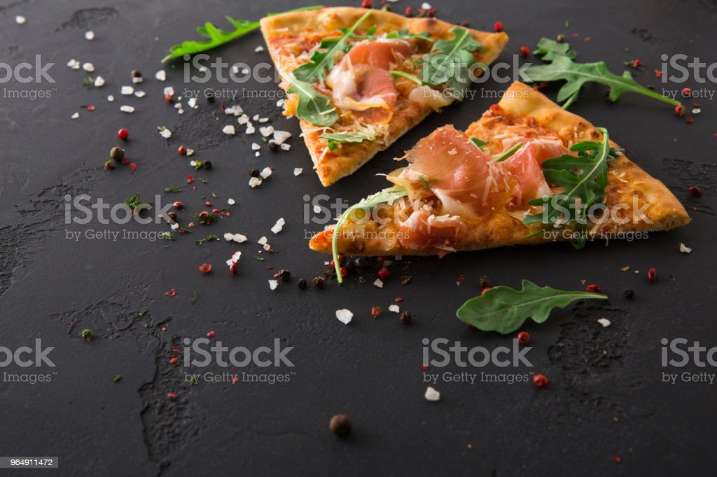Pizza with prosciutto and rocket salad copy space royalty-free stock photo