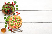 Hot italian pizza on wooden table with space on text. Top view