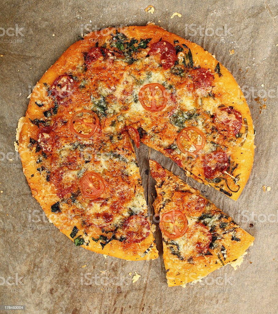 Pizza with Salami and Tomatoes royalty-free stock photo