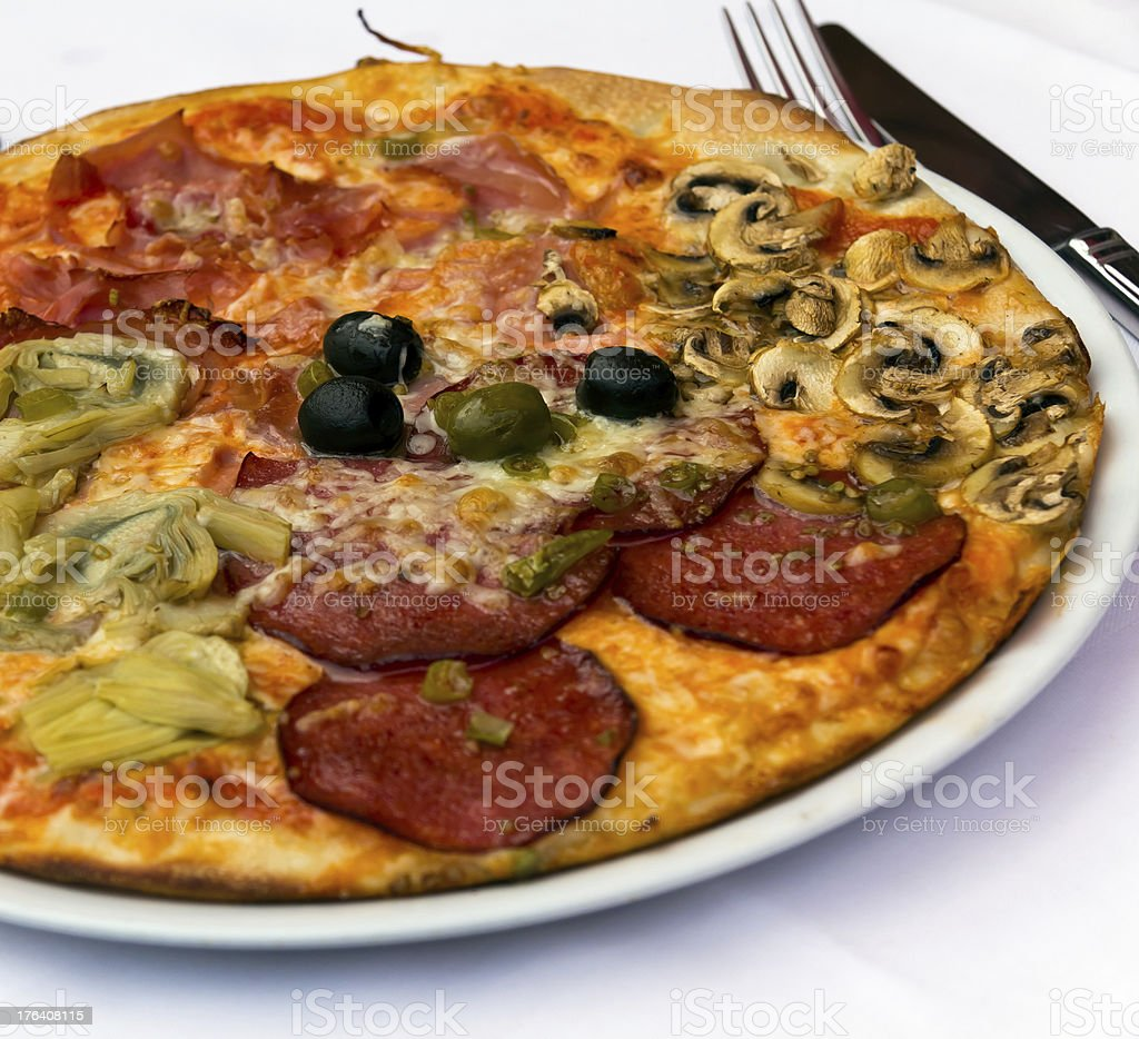 Pizza with Salami, Tomatoes and Chili Pepper royalty-free stock photo