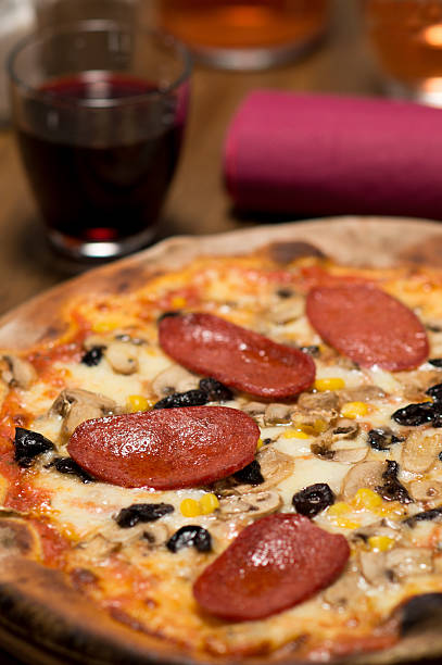 Pizza with sausages stock photo