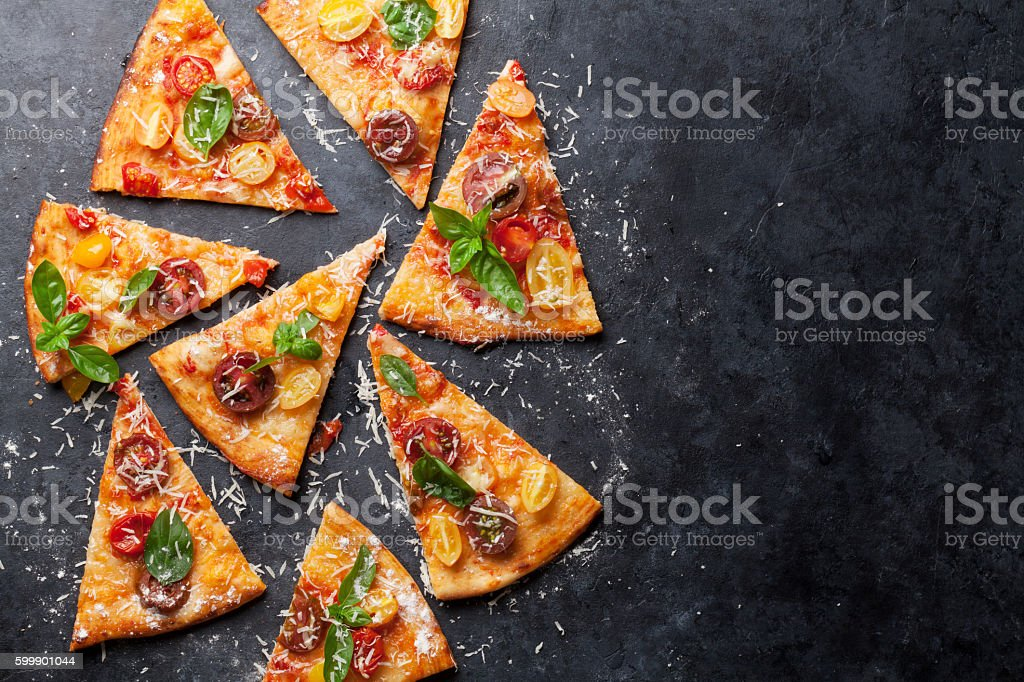Pizza with tomatoes, mozzarella and basil stock photo