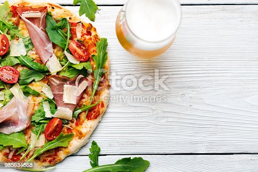 Pizza with beer on white