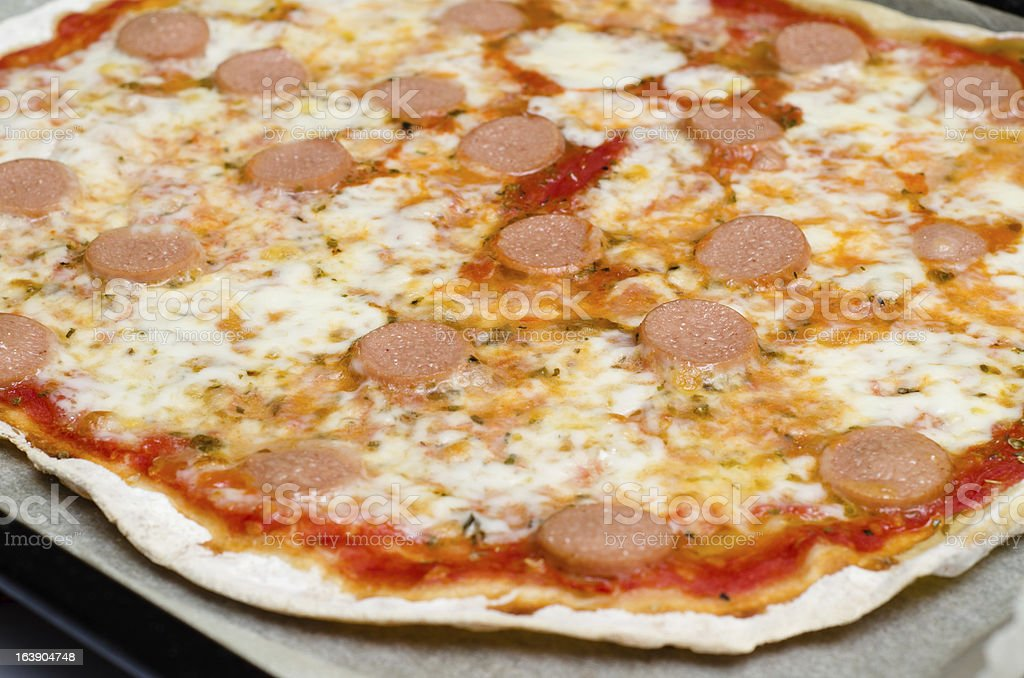 Pizza with wurst, mozzarella and tomato royalty-free stock photo