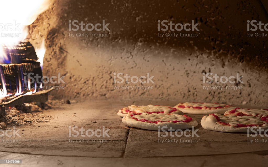 Pizzas in the oven royalty-free stock photo