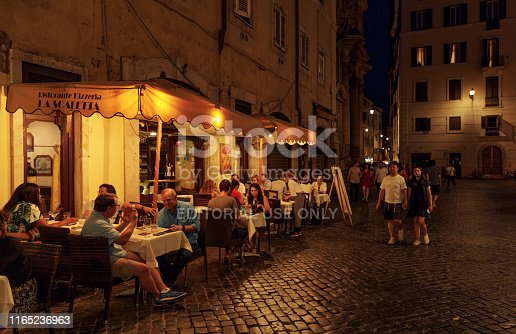 Tourists are enjoying their dinner in La Scaletta Pizzeria restaurant which is in Via della Maddalena street in old town of Rome. Rome, Italy's capital, is a sprawling, cosmopolitan city with nearly 3,000 years of globally influential art, architecture and culture on display.