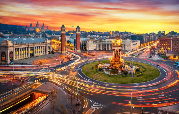 Plaça d'espanya (Plaza de españa - spain square) long exposure at sunset in Barcelona Long exposure photo of Fira de Barcelona, Plaça d'espanya (Spain square) and montjuic mountain in Barcelona at sunset with car light trails . Spain barcelona spain stock pictures, royalty-free photos & images