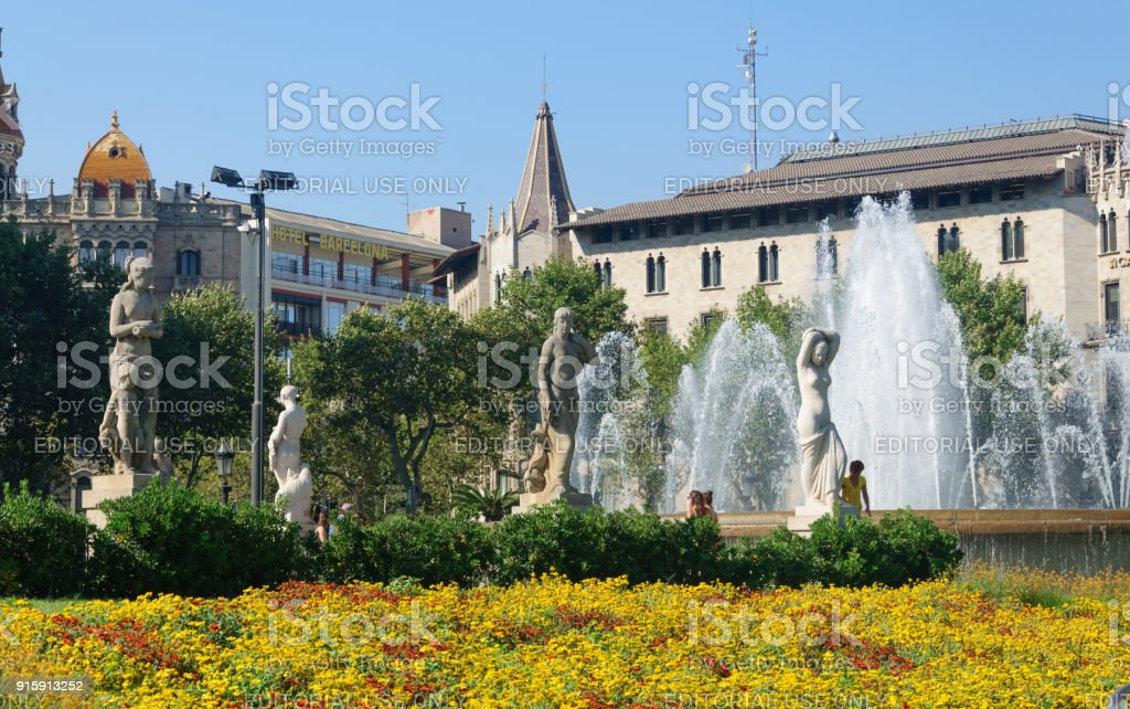 Placa Catalunya fountains and flowerbed stock photo