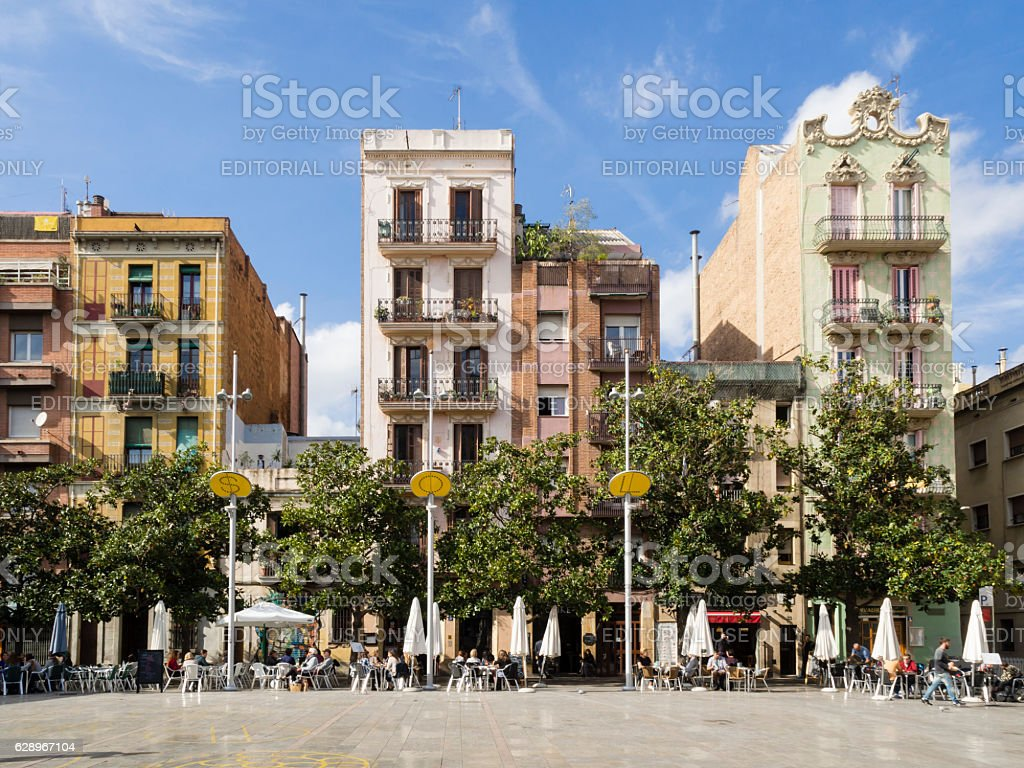 Placa del Sol, Barcelona Barcelona, Spain - October 16, 2015: People are enjoying the autumn sun outside at the Placa del Sol in Barcelona's trendy Gracia residential district. Architecture Stock Photo
