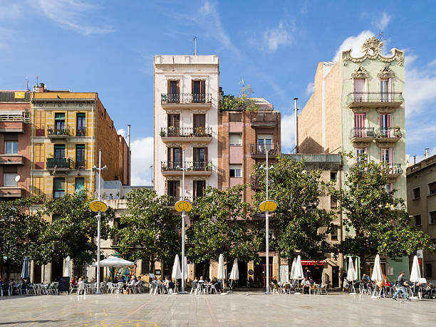 Placa del Sol, Barcelona Barcelona, Spain - October 16, 2015: People are enjoying the autumn sun outside at the Placa del Sol in Barcelona's trendy Gracia residential district. gracia baur stock pictures, royalty-free photos & images