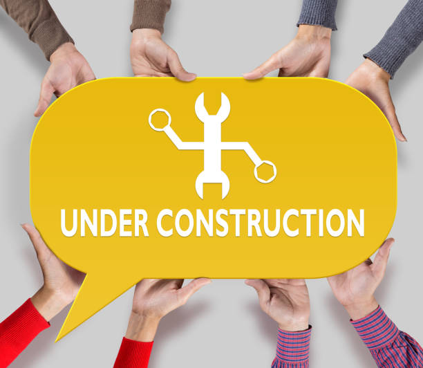 placard with under construction icon - under construction icon foto e immagini stock