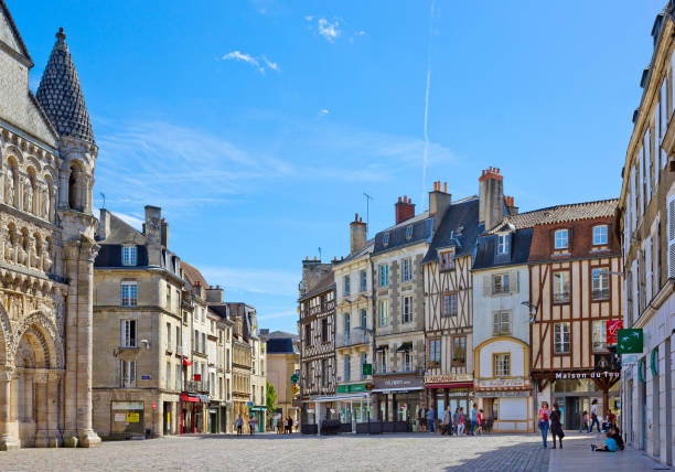 Place Charles de Gaulle with historical buildings in Poitiers, France Poitiers, France  - May 14, 2017:  Place Charles de Gaulle with historical buildings with people around romanesque stock pictures, royalty-free photos & images
