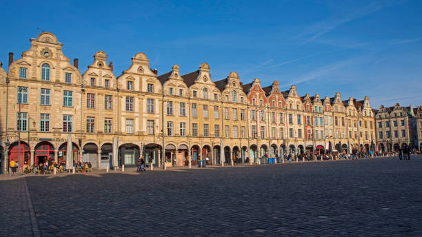 Place d'Arras in France with typical houses Facades of typical Flemish medieval houses in a square of Arras in France hauts de france stock pictures, royalty-free photos & images