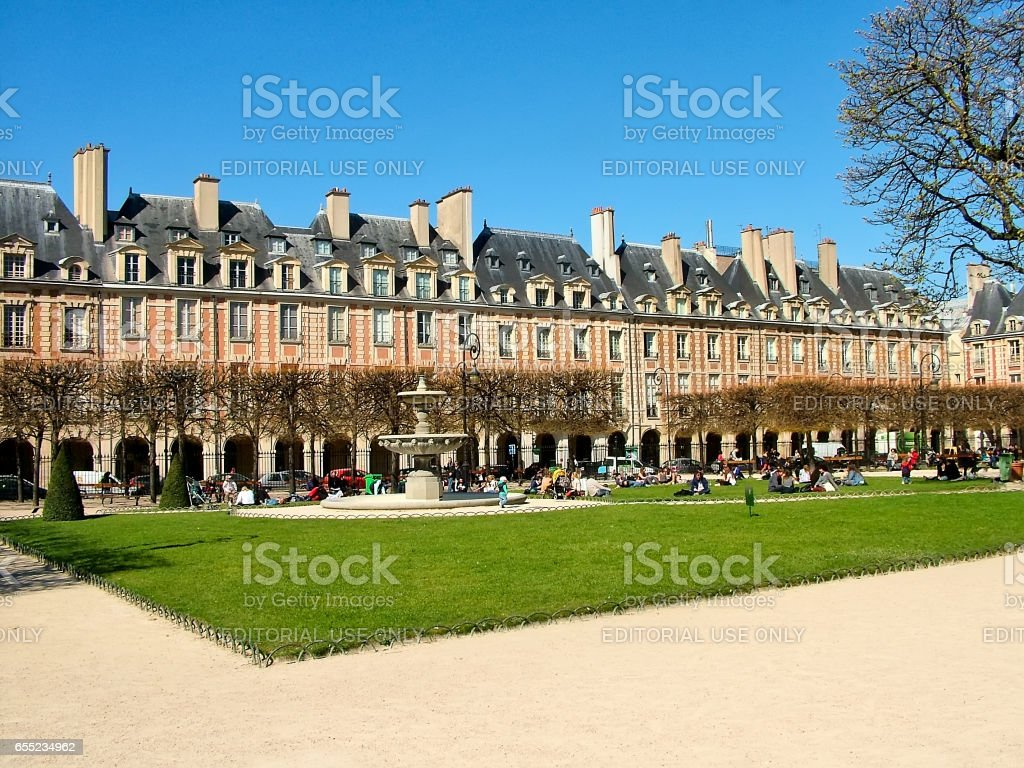 Place des Vosges in Paris in the spring sunny day stock photo