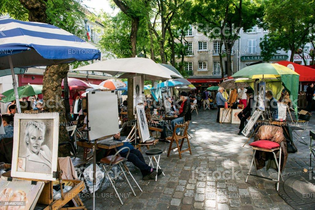 Place du Tertre Paris with artists ready to paint tourists stock photo