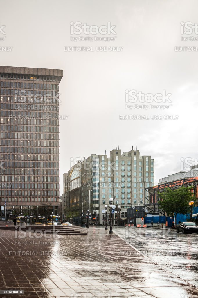 Place D'Youville during heavy rain in old town street with cars stock photo