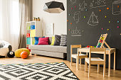 Shot of a creative room for children with a place for play and learn