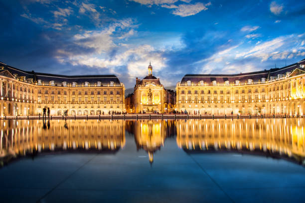 Place la Bourse in Bordeaux, the water mirror by night, France Place la Bourse in Bordeaux, the water mirror by night, France bordeaux stock pictures, royalty-free photos & images