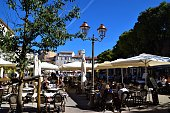 Antibes, France - October 3 2019: people and restaurants at Place Nationale town square daytime