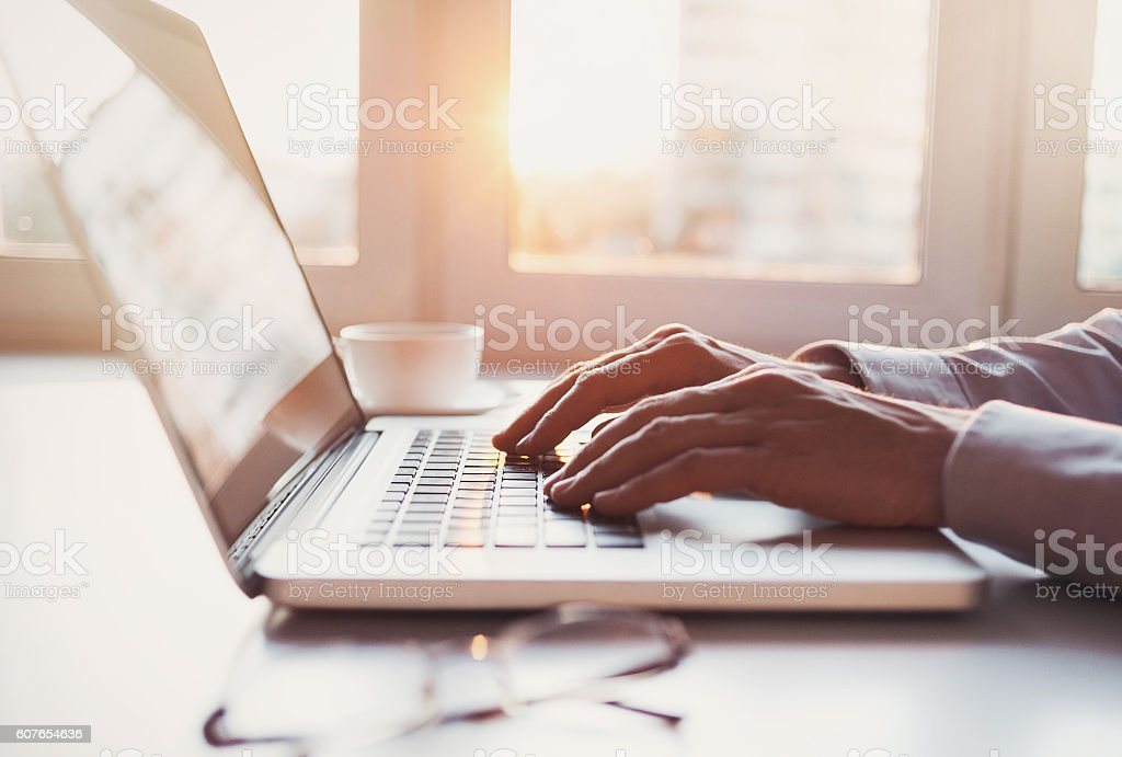 Place of work, man using laptop computer stock photo