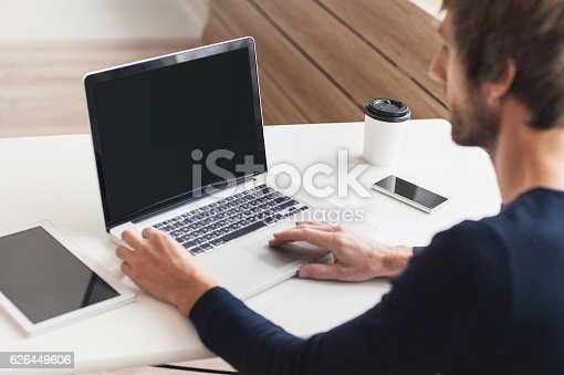 istock Place of work, man using laptop computer 626449606