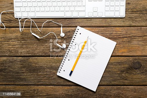 istock Place of work, on weathered loft style table, top view 1145564139