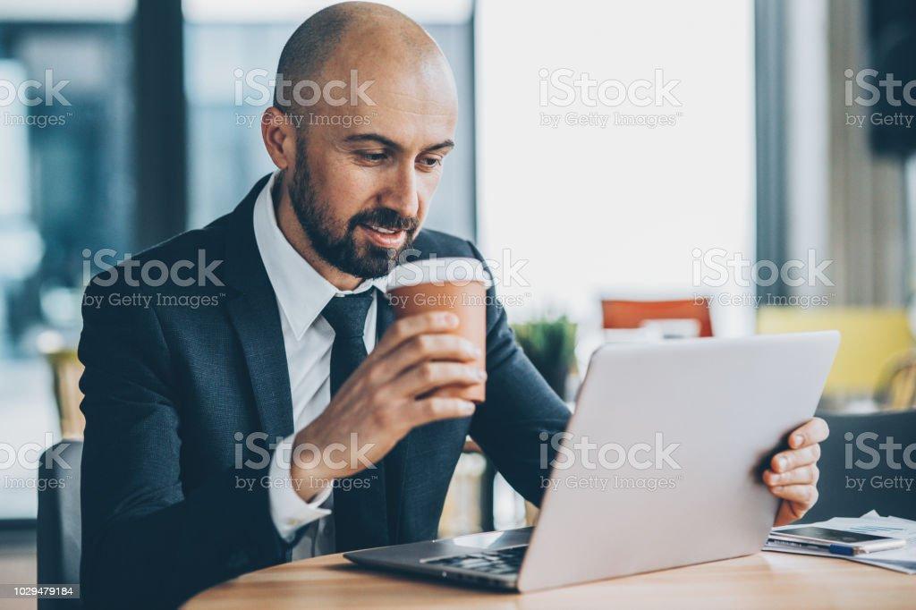 Businessman at work drinking coffee