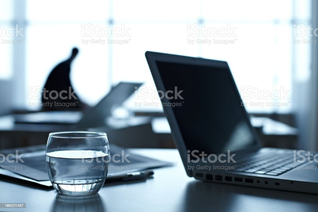 Place of work with laptop and glass of water