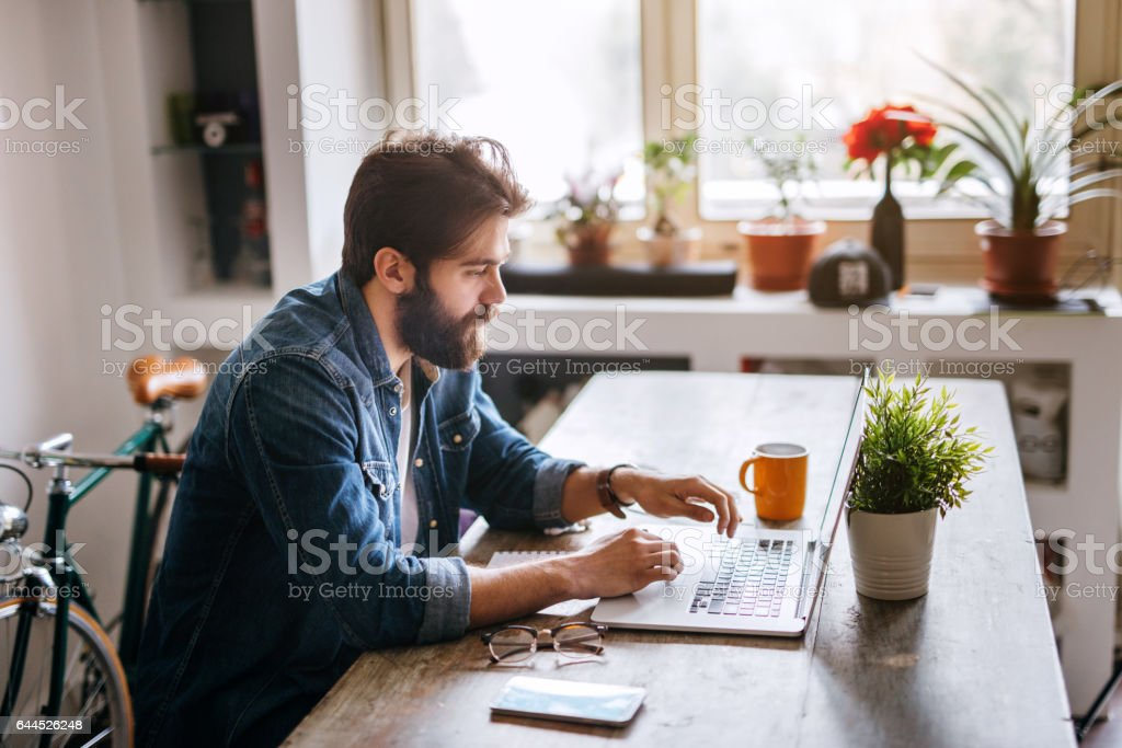 Creative man working in his modern home office