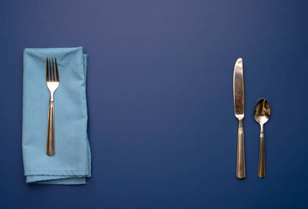 place setting on blue background with space for your plate - blue table setting stock photos and pictures