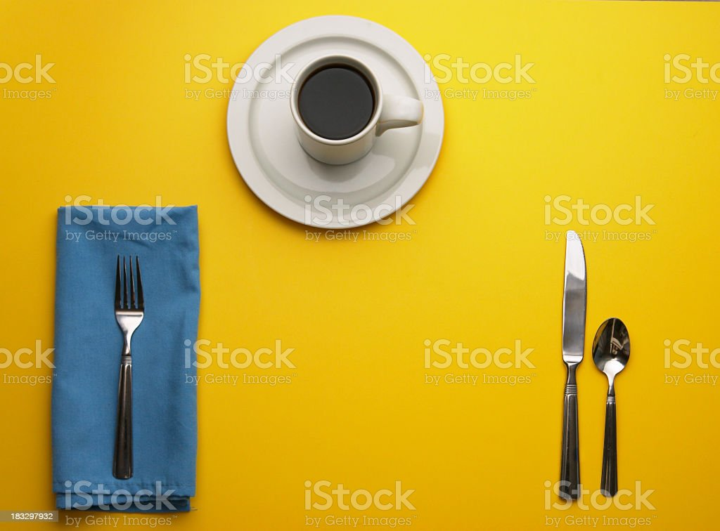 Place Setting on Yellow with Room for Your Plate royalty-free stock photo