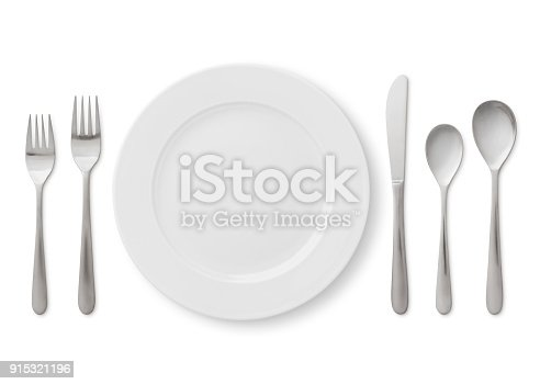Formal table place setting - plate, forks, spoons and knife isolated on white (excluding the shadow)