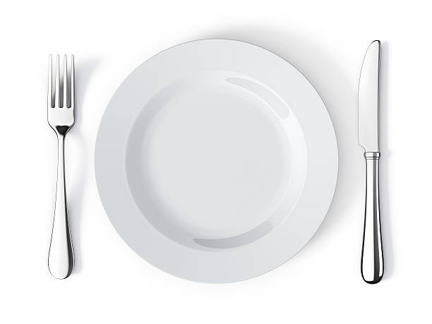 place setting with plate, knife and fork - table knife stock photos and pictures