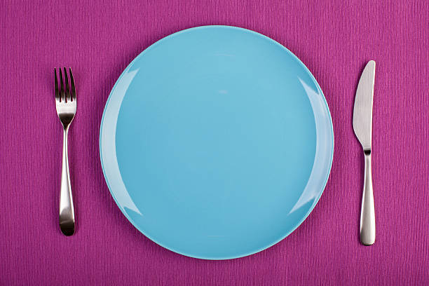 place setting with plate, knife and fork - blue table setting stock photos and pictures