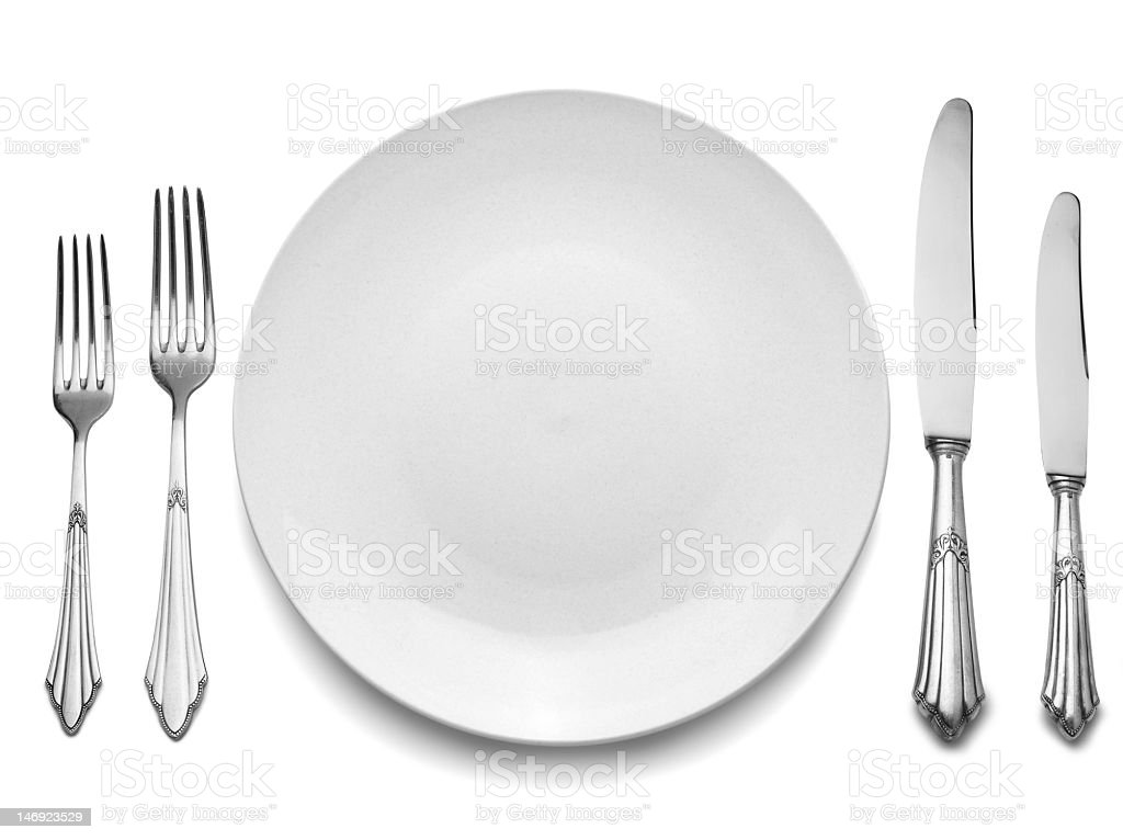 Place setting with white plate and utensils stock photo