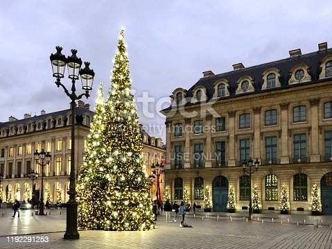 Place Vendôme during Christmas, with Christmas tree and floor lamp in Paris, France - November 29, 2019