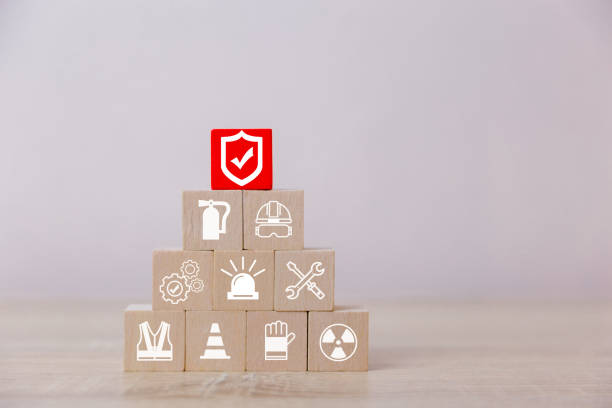Place wooden blocks on the pyramid. 100 percent work safety concept. Place wooden blocks on the pyramid. 100 percent work safety concept. fire natural phenomenon stock pictures, royalty-free photos & images
