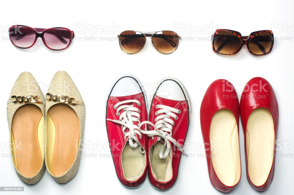 Placed shoes and sunglasses on a white background styles - lifestyles royalty-free stock photo