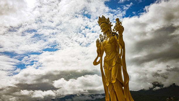 Placid On the top of the mountain at Kuenselphodrang, you will find such devotees of Buddha looking over the city of Thimphu bodhisattva stock pictures, royalty-free photos & images