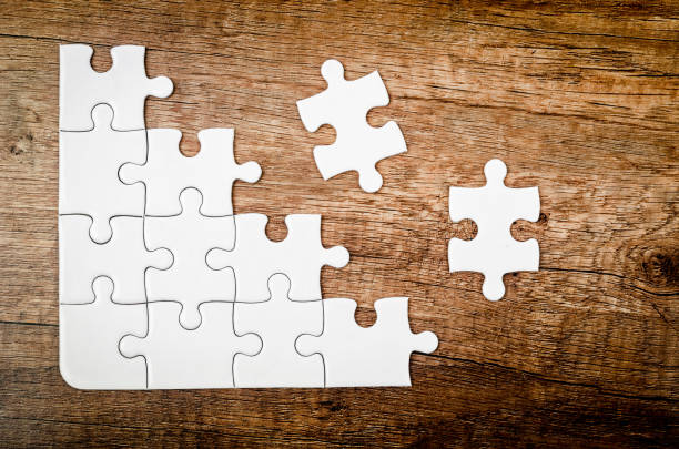 placing missing piece of puzzle - icon set healthy foto e immagini stock