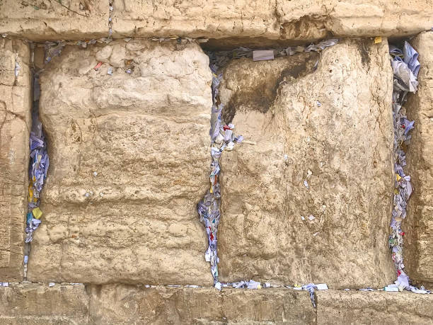 Placing notes in the Western Wall Jerusalem. stock photo