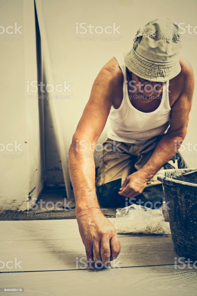 Placing tile spacer stock photo