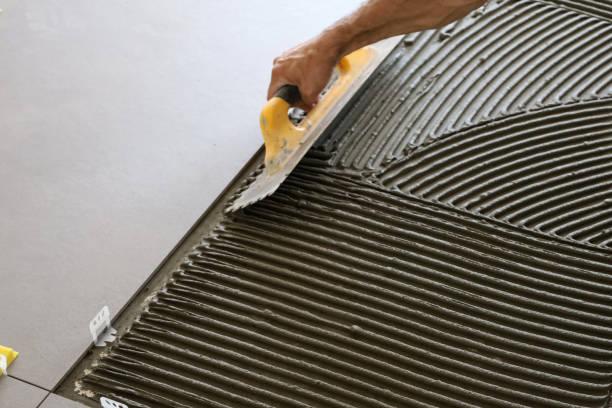 Placing tiles stock photo