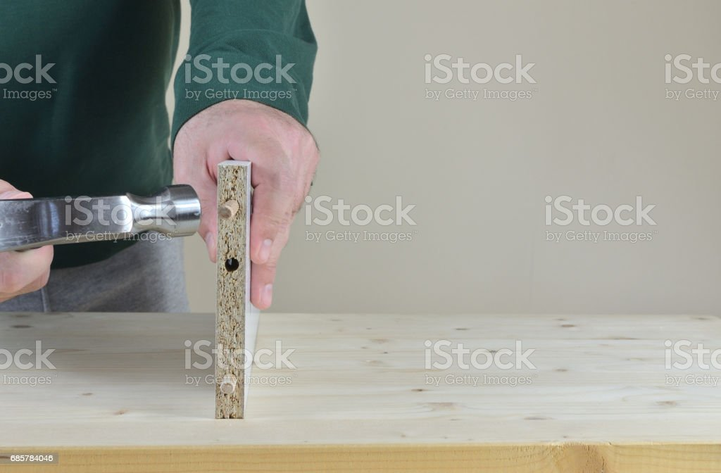 Placing Wooden Dowels royalty-free stock photo