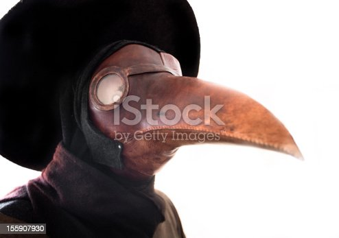 A primitive gas mask in the shape of a bird's beak. A common belief at the time was that the plague was spread by birds. It was thought that by dressing in a bird-like mask, the wearer could draw the plague away from the patient and onto the garment the plague doctor wore. The mask also included red glass eyepieces, which were thought to make the wearer impervious to evil. The beak of the mask was often filled with strongly aromatic herbs and spices to overpower the miasmas or