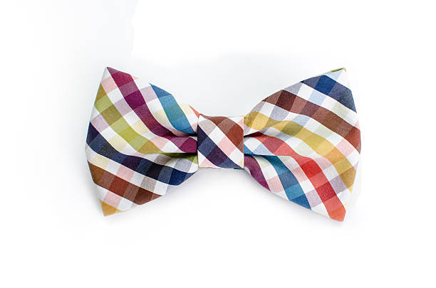 Plaid bow tie close up on white isolated background Plaid bow tie close up on white isolated on white background bow tie stock pictures, royalty-free photos & images