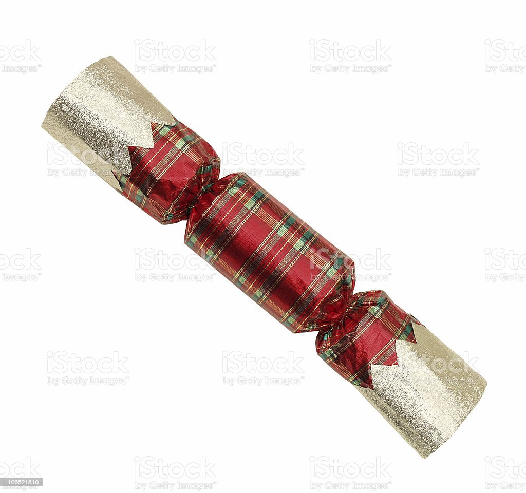 Plaid, metallic Christmas ornament in  shape of a candy wrapper. stock photo