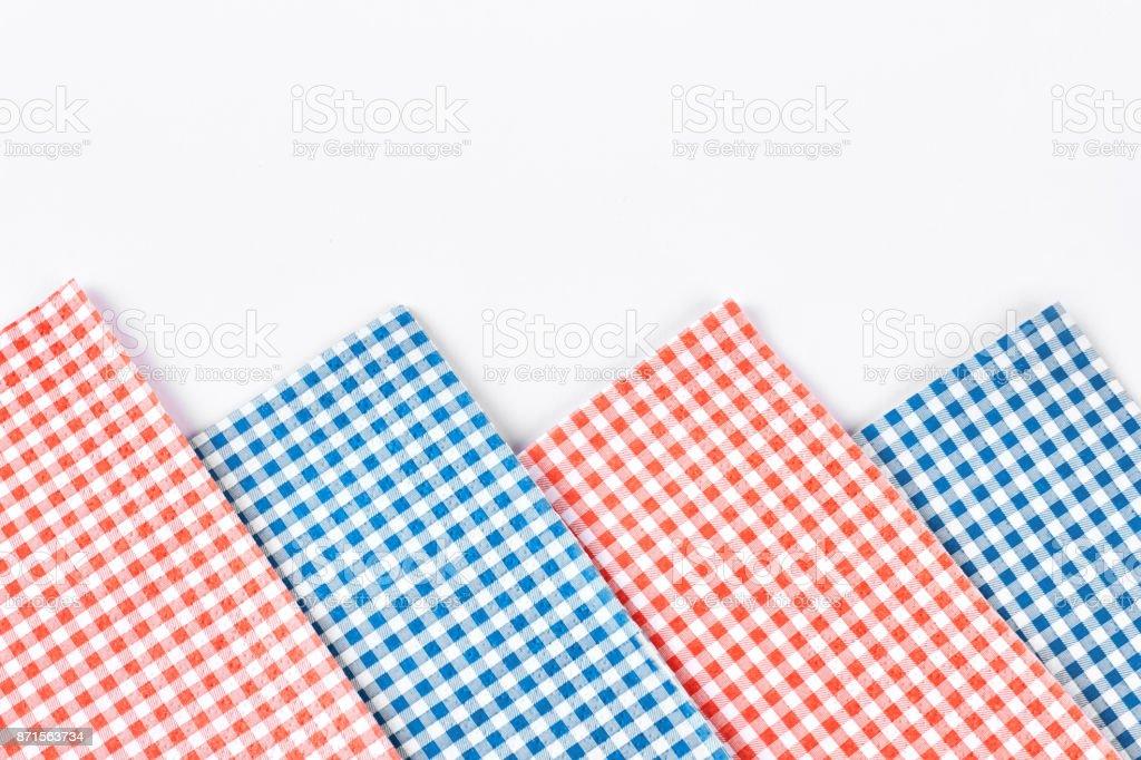 Plaid table napkins, white background. stock photo
