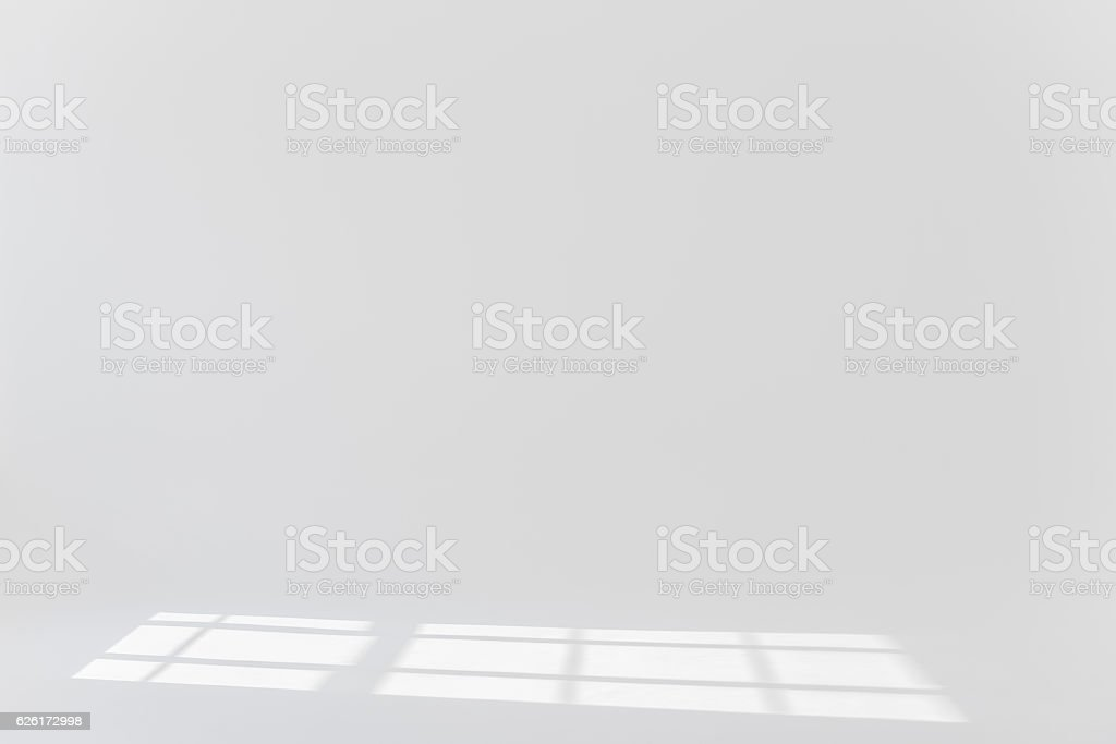 Plain background with sun light and shadows stock photo
